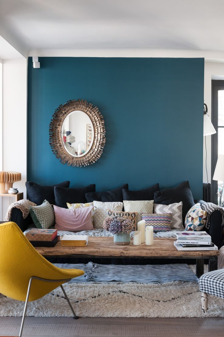 Like the blue wall, the mirror that is put to the side, the pop of colour with the yellow chair and the assorted pillows.