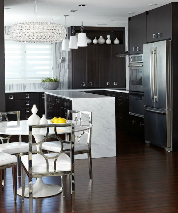 Atmosphere Interior Design    Contemporary, modern kitchen design with espresso stained kitchen cabinets with marble countertops, Nuevo Bulle Pendant , marble Saarinen table, polished chrome dining chairs and Jonathan Adler Vidalia Bud Vase.
