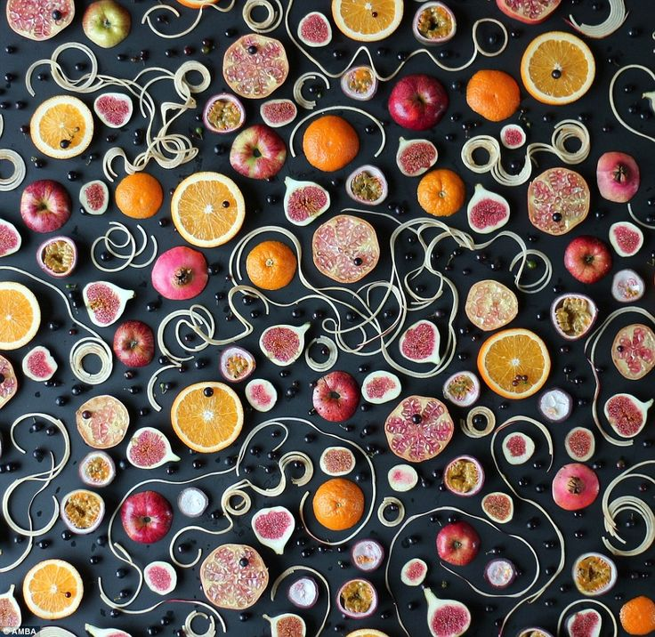An autumn fruit salad with red apple 'spaghetti', pale pink pomegranates, turkish figs, black dessert grapes and an orange and passion fruit dressing. Amber said: 'The black grapes were from my little vine. They are very sweet and I scattered them at the end and the sunlight just caught them'