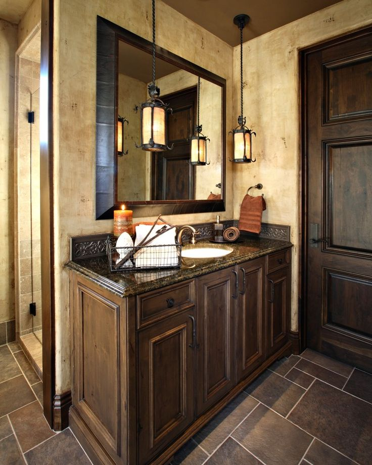 ~ Beautiful Spanish-style bathroom. Love the dark choco brown palette, large mirror, pendant lighting, countertop and shower on the side.  Designed by Amy Gutierrez; this is clearly my kind of style. ~