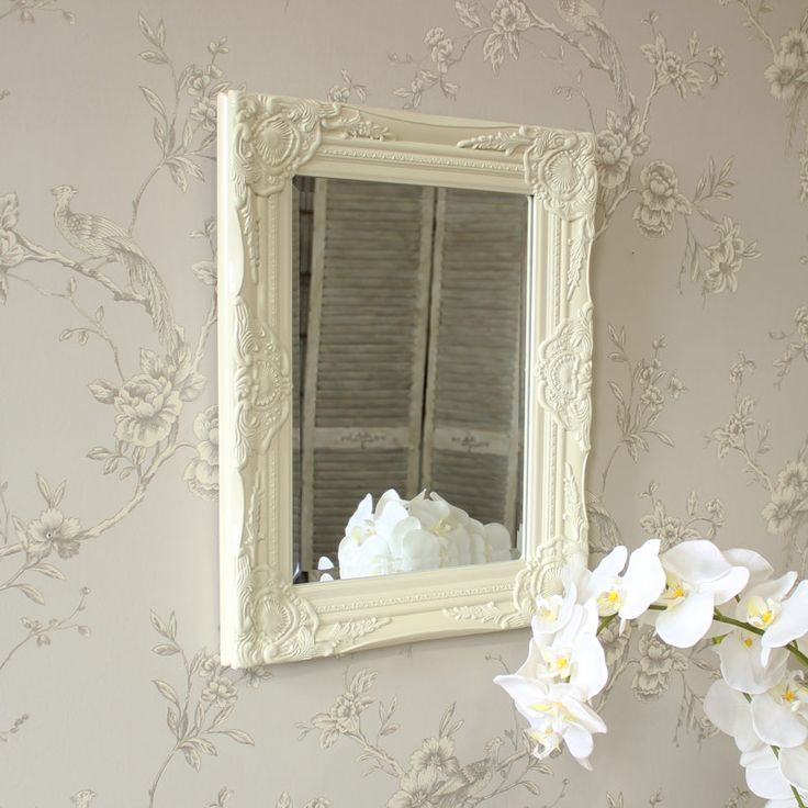 Ornate Cream Wall Mirror An ornate 'Rococo' style framed mirror Made from plaster it has an aged effect white painted finish and bevelled mirror insert Made from plaster it has an aged effect white painted finish and bevelled mirror insert Fixtures for easy wall mounting are attached or it looks equally effective leant against a wall