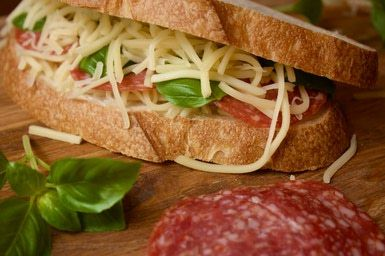 Salami, Cheese, and Basil Sandwich. The gruyere and swiss cheese, while both both nutty and rich, become almost caramel-like when paired with the cured meat.