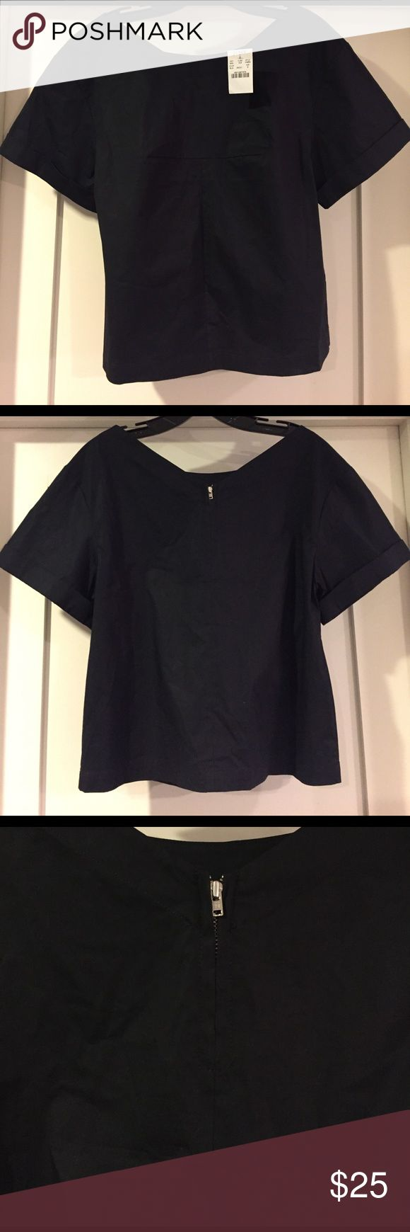 J Crew beautifully cut top with cute zipper detail NWT J Crew top in black. Very pretty and special cut to this top. Appreciated more in person to see cut. Has slight stretch to it. So cute with skinny jeans or leggings and heels/booties. Dress up with statement necklace or earrings. Very clean lines and slightly cropped. Please ask all questions before buying. J. Crew Tops Blouses