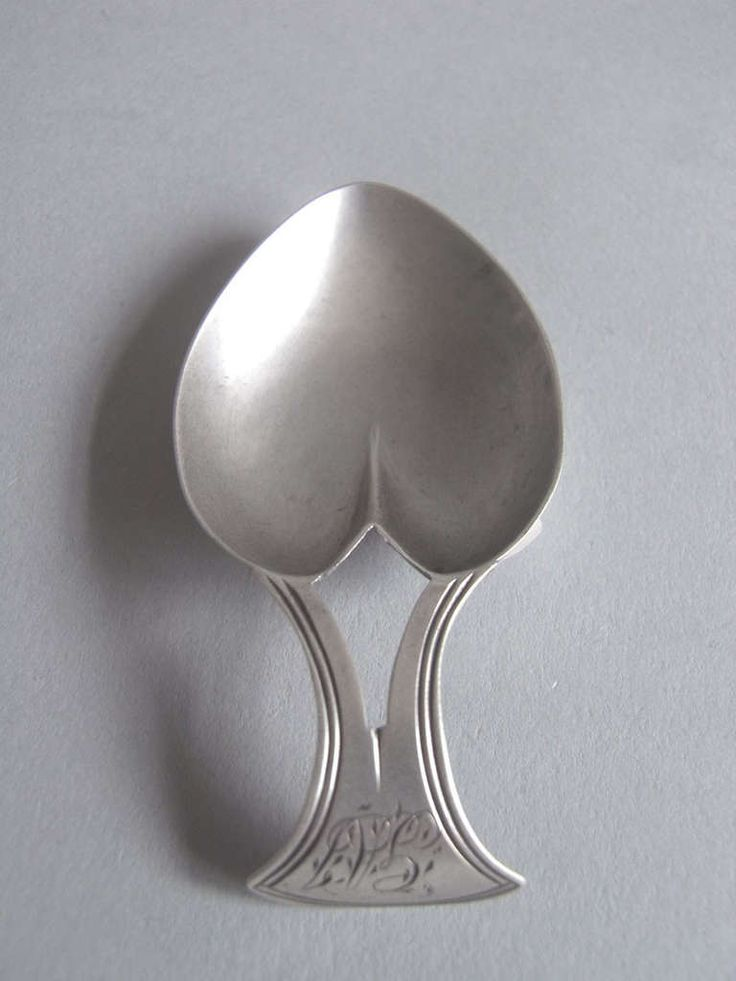 A rare George III Heart Caddy Spoon made in Birmingham in 1808. The Caddy Spoon is unusually shaped as a heart and displays a bi-fucated handle, with triple thread edge, which is engraved at the top with a set of contemporary script initials