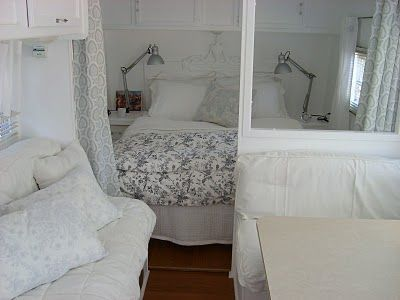 Pretty Vintage Trailer bedroom. I like that it has a futon sofa too for the kiddos to come with us ;)