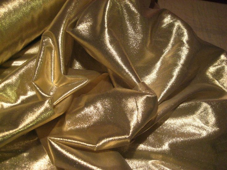 Beautiful 25 yard Gold Lame Fabric roll with super fine weave of metallic yarns.