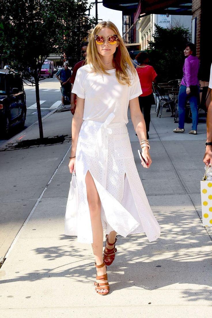 White tee, split skirt, brown leather platforms, reflective sunnies.