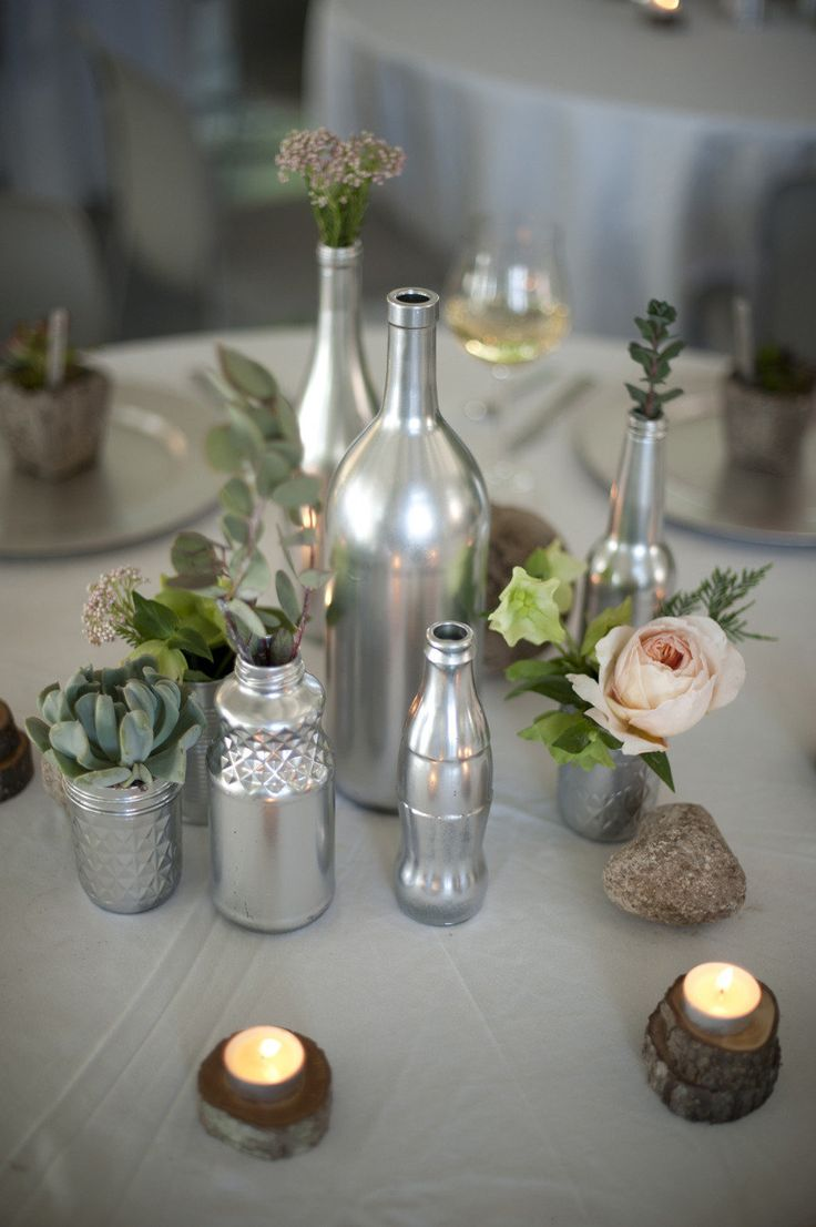 Spray paint wine bottles loooove it could strip them for Painted wine bottle wedding centerpieces