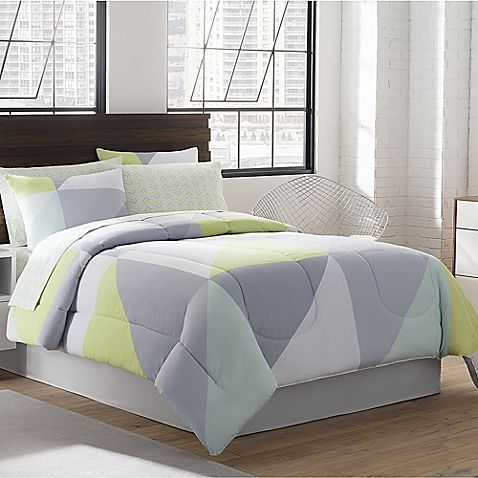 color block pattern of triangles in grey green and white hues this