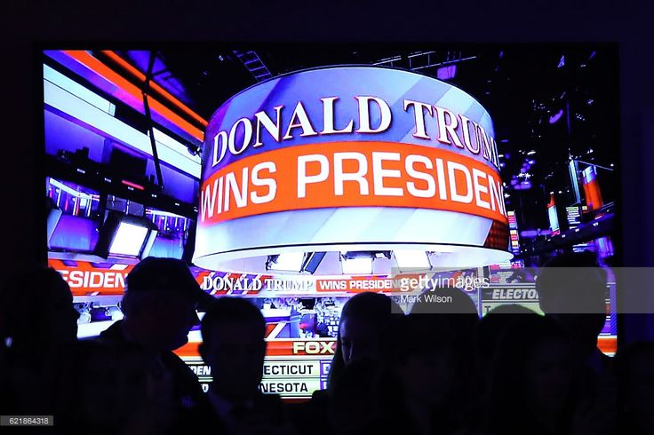 People celebrate during the call for Republican president-elect Donald Trump at his election night event at the New York Hilton Midtown on November 9, 2016 in New York City. at the New York Hilton Midtown in the early morning hours of November 9, 2016 in New York City. Donald Trump defeated Democratic presidential nominee Hillary Clinton to become the 45th president of the United States.