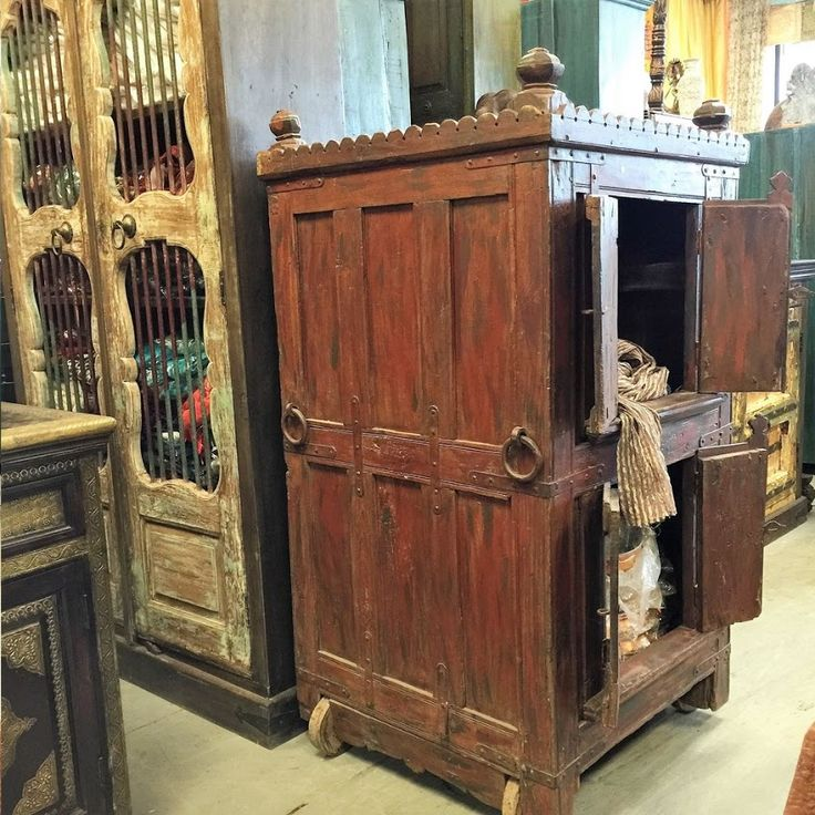 https://www.houzz.com/photos/93220274/Consigned-Antique-Armoire-Furniture-Vintage-Indian-Red-Cabinet-on-wheel-rustic-armoires-and-wardrobes