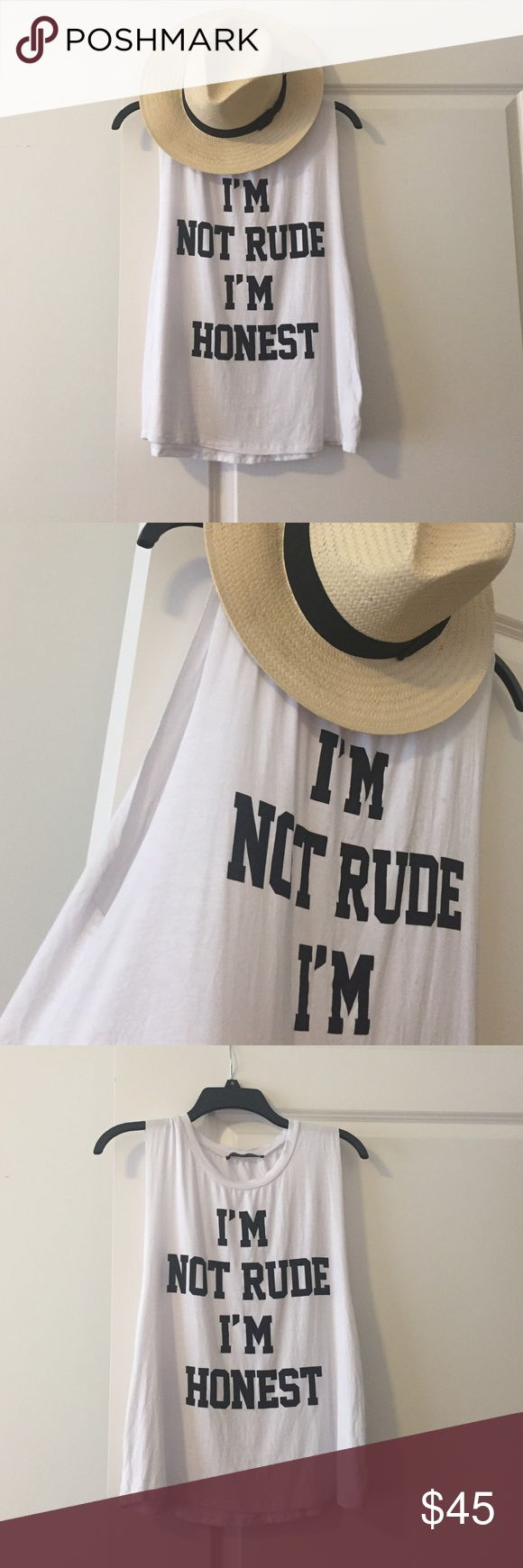 Honest Muscle Tee Softest tee with a no-nonsense attitude statement. For the girl who likes to call it like it is! Raw edge style cut off sleeves. Never worn. But I did take tags off and used wrinkle release spray on it for the photo. Perfect for summer! Oversized small. Still not fully sure if I want to sell but haven't worn it yet. Did pay a good bit for this from a boutique at the beach. Let me know if interested. Tops Muscle Tees