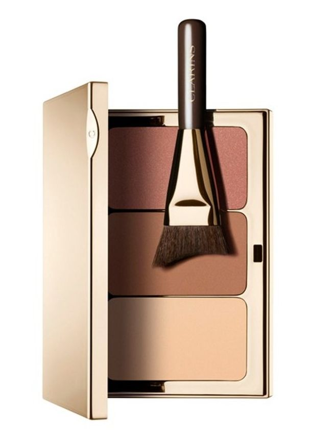 Using the angular contouring brush, apply the lightest shade to the center of the forehead, upper eyelids, above your cheekbones, nose and the area just above lip and chin. Then, apply the deepest shade to the top of the forehead, sides of your nose, beneath the cheekbones and the sides of the chin. Finally, apply blush to the apples of the cheeks.
