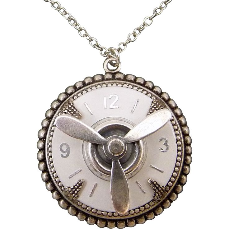 Time Flies Pendant Necklace This exquisite necklace was handcrafted using a vintage watchface and secured it to a beautiful antiqued silver setting; adorned with a silver propeller. Super pretty, super cool. The locket measures 1-1/4 inches in diameter and is hung from a 17-inch silver plated chain with lobster claw clasp.  ♥ Very feminine and very steampunk!