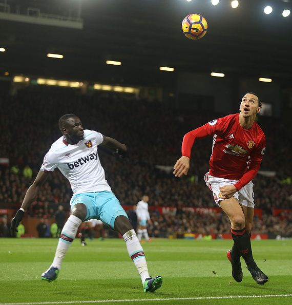 Zlatan Ibrahimovic of Manchester United in action with Cheikhou Kouyate of West Ham United during the Premier League match between Manchester United...