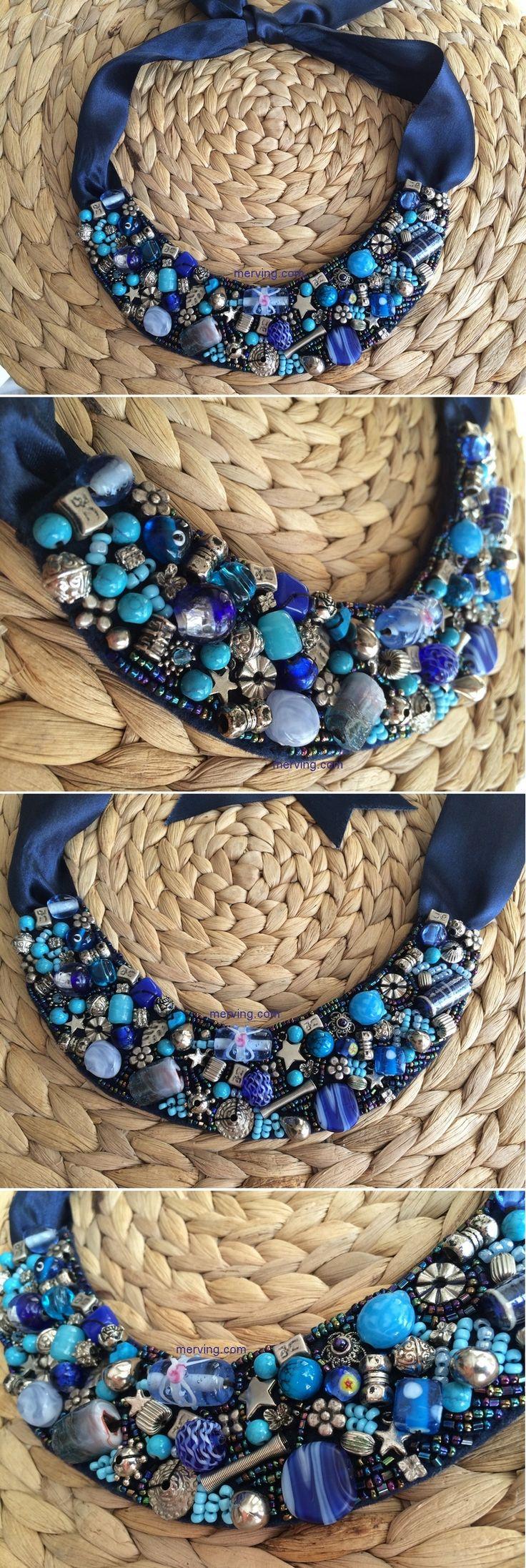 Keçe üzerine el işlemesi mavi tonlarında içinde gümüş rengi taşlar bulunan…