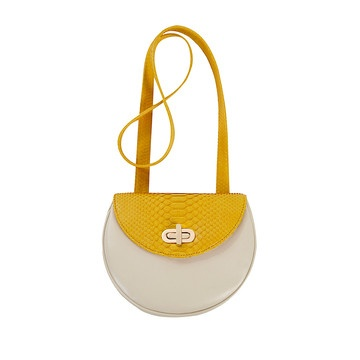 This adorable cross body bag has an on-trend ladylike silhouette with a turn clasp detail. Not to mention, the natural tone lamb leather is a great contrast with the exotic python skin, making it an everyday bag just as comfortable in the daytime as it is in the nighttime.