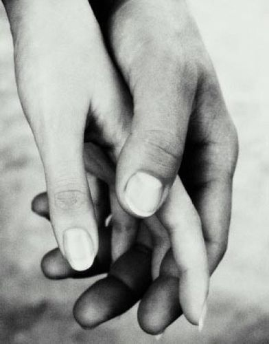 Couples hands touching, close up. Christian Adams