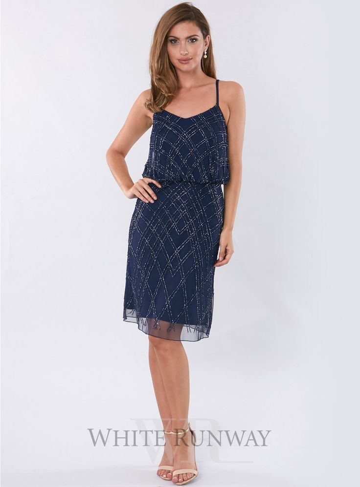 Renella Dress. A stunning cocktail length dress perfect for formals, black tie events and wedding guests. A flattering style with a loose fit bodice and sequin beaded detailing throughout.