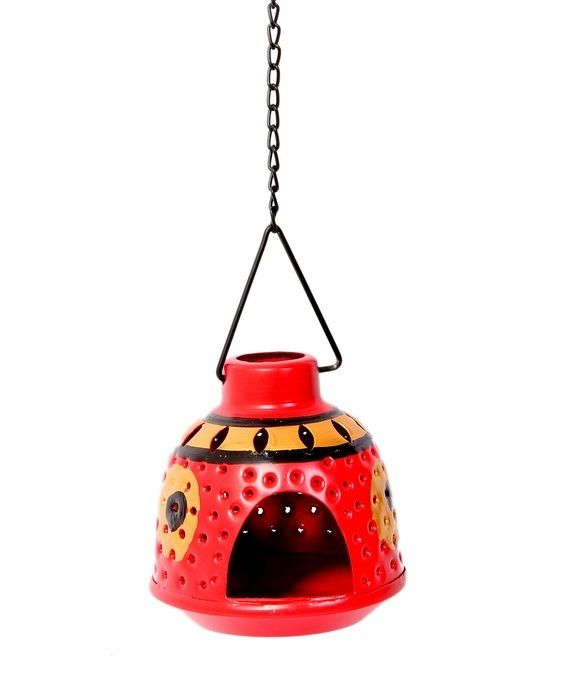 This Red and Gold hand painted metallic tea light holder is a new and ethnic concept in modern households. It comes with a detachable chain hence it can be hung as well as kept inside the house. Beautiful crafting on it enables spread of light in all directions, making the surroundings aesthetically pleasing. Will get delivered with two tailored made tea lights.