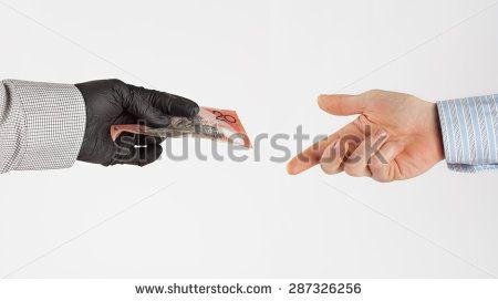 Black market money exchanges hands