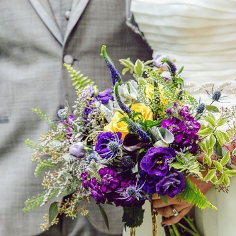 An amazing bouquet by @seasonsinthecountrymuskoka. The contrasting colours of yellows and purples is one of my favorites. Structured yet wild at the same time.