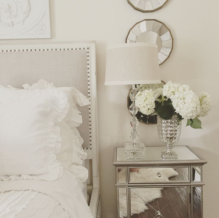 easy bedroom make over mirrored nightstand, white roses, white bedding, mercury glass