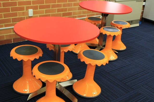 Flip-top tables with wobble stools