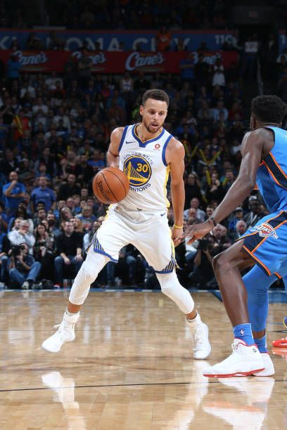 Stephen Curry of the Golden State Warriors handles the ball against the Oklahoma City Thunder on November 22 2017 at Chesapeake Energy Arena in...