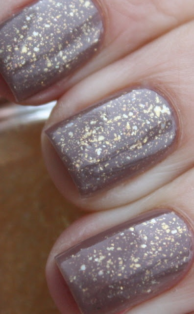 OPI Over the Taupe + Essie As Gold As It Gets. I love the layered look that you get when you add glitter over a solid color.