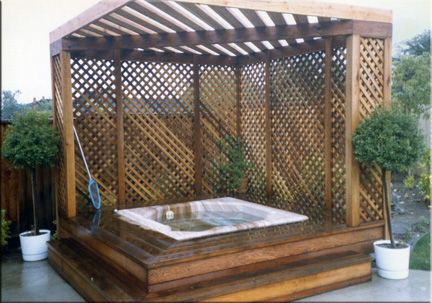 I want something simple like this (without the raised deck around the tub, thats too complicated) in the backyard. Just a couple sides made of lattice to add privacy, put my climbing flowers at the base, and pour a concrete slab underneath for a hot tub...not too much to ask for right?