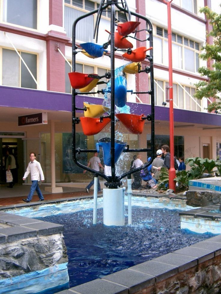 """The Bucket Fountain is an iconic kinetic sculpture of Wellington, capital city of New Zealand. It can be found in Cuba Mall, which is part of Cuba Street. It consists of a series of """"buckets"""" that fill with water until they tip, spilling their load into the buckets and pool below. The fountain was designed by Burren and Keen and erected in 1969"""