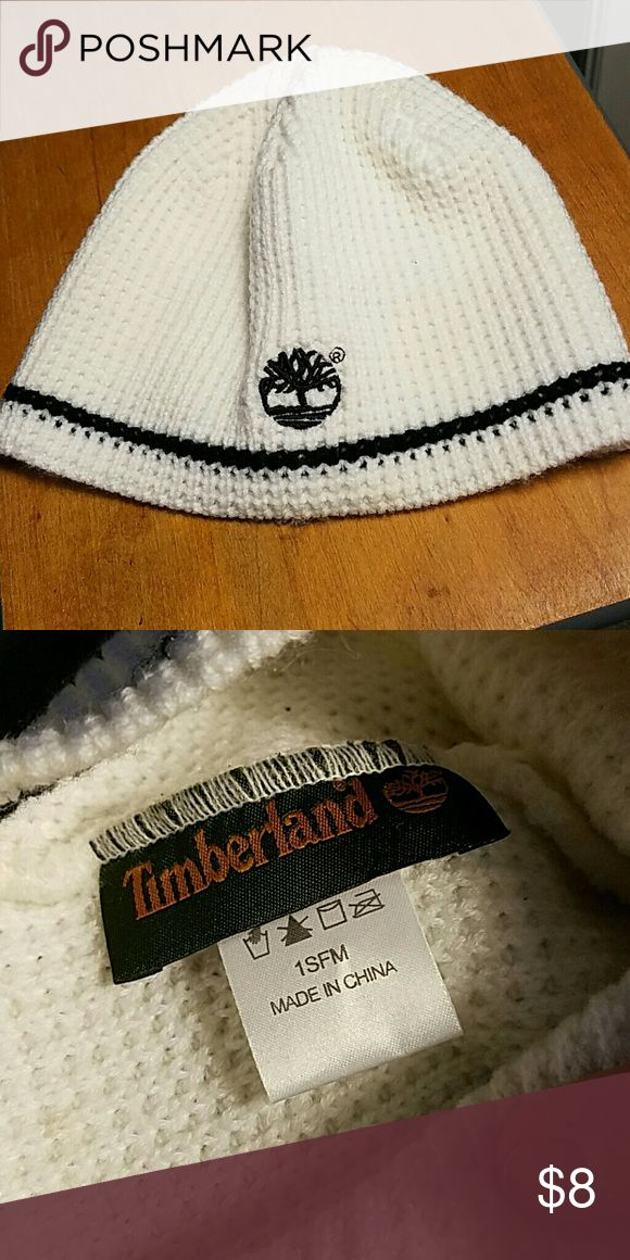 Timberland Knitted Hat White knitted women's Timberland hat. Black stitching accents the hat. One size fits most. Worn once. Timberland Accessories Hats
