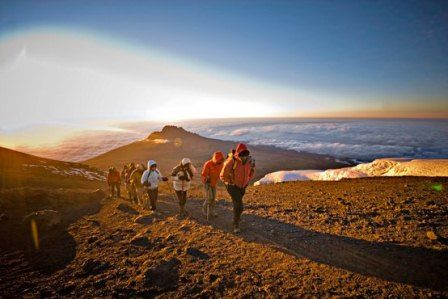 How Do I Prepare to Climb Kilimanjaro? TONS of info here.  And it looks like I'm already pretty much there with training, which makes this feel like a real possibility for someday.