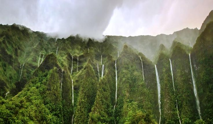 "O'ahu's Mystical Land Of A Thousand Waterfalls..............If this stunning waterfall landscape seems familiar to you, don't be alarmed. This particularly other-worldly region of Oahu served as the backdrop for the popular TV series, ""Lost."""