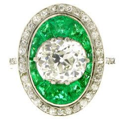 Antique old mine cut diamond and emerald ring: