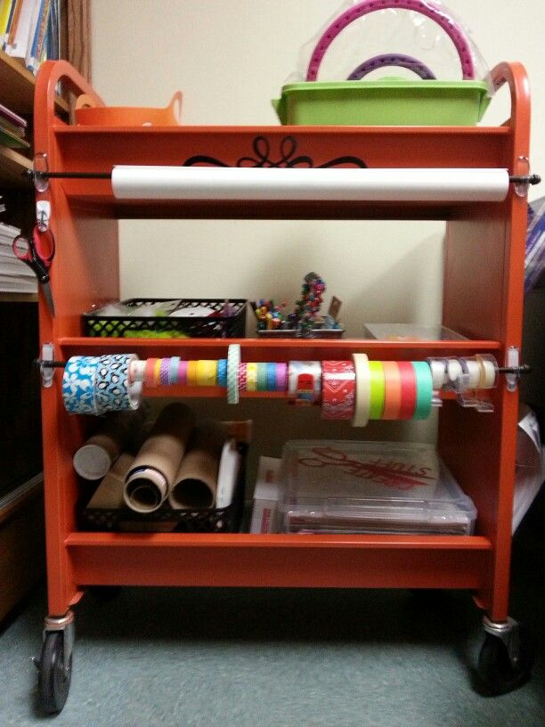 Another back view of the Makerspace Mobile cart. These are curtain rods hung on command adhesive hooks. We have craft paper and scissors for cutting it and different types of tape.