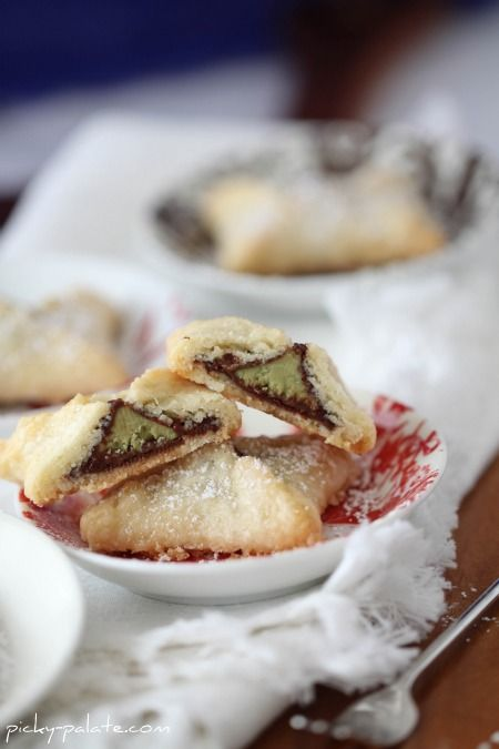 Kiss Pies picky-palate: Put a Hershey's chocolate kiss in the center of a round of ready made pie crust. Tuck up the sides to make a tiny four corner dumpling. Pinch the seams. Brush with eggwhite.  Sprinkle with sugar and bake. #Cookies #Kiss_Pies #picky_palate