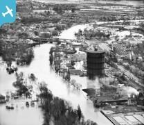 The River Thames in flood around the town Gas Works and Staines Bridge, Egham, 1947