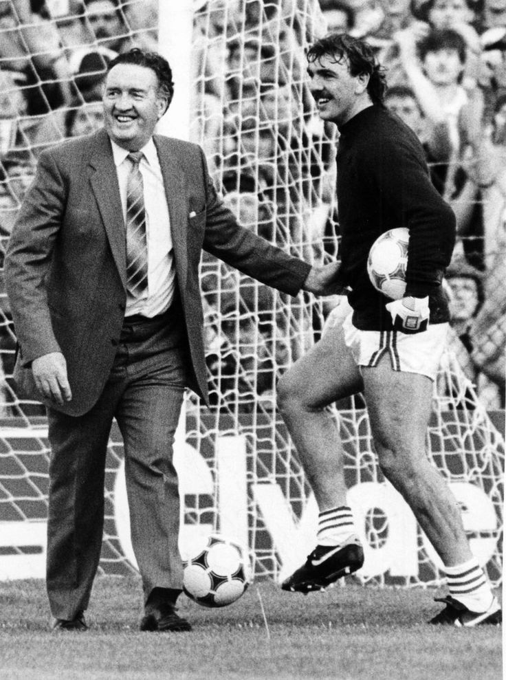 Jock Stein shares a joke with Welsh goalkeeper Neville Southall before the game in which he tragically collapsed and died