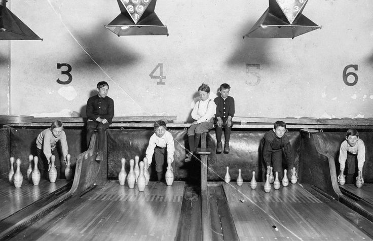Pin-boys work in the Arcade Bowling Alley in Trenton, New Jersey, on <span>December 20, 1909</span>. The boys worked until midnight and later.