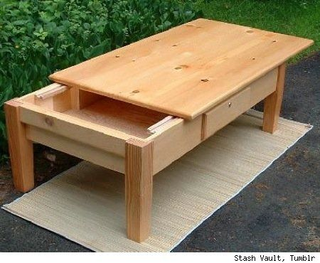 Coffee table with a sliding top to reveal the hidden compartment.
