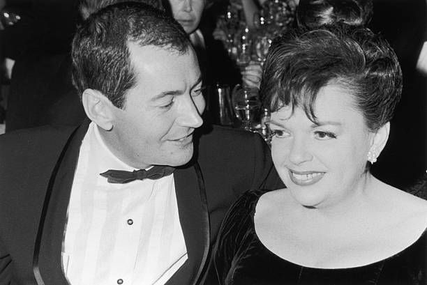 Married American actors Judy Garland (1922 - 1969) and Mark Herron (1928 - 1996) at a formal Hollywood event, California.