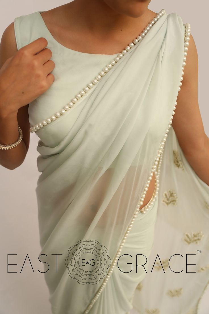 Classy girls wear pearls. We took it to a higher level and embedded them with touch, love, and care on the serene Pearl & Icy Mint Saree that's made with sheer yet royal pure silk chiffon. This saree will help you stun with a little laid-back glamour and complement your simplicity with ease. PRICE: INR 6,528.00; USD 96.00 To buy click here: https://goo.gl/sTqjeC For order related inquiries, please reach out to us at orders@eastandgrace.com. With love, EAST & GRACE www.eastandgrace.com