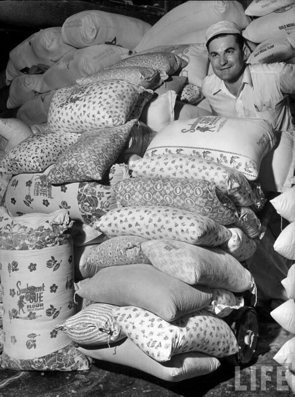 After flour companies realized women were using their cotton bags to make dresses for their daughters, they started adding colorful inks and patterns!  1939