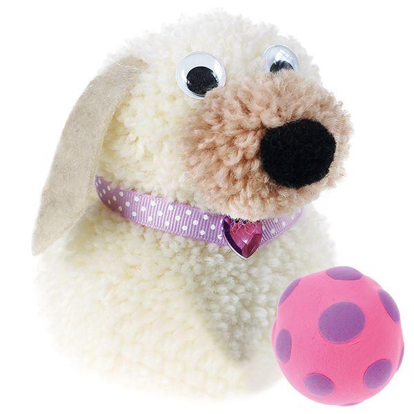 Pompom-laitteen avulla valmistettu pörröinen koira.