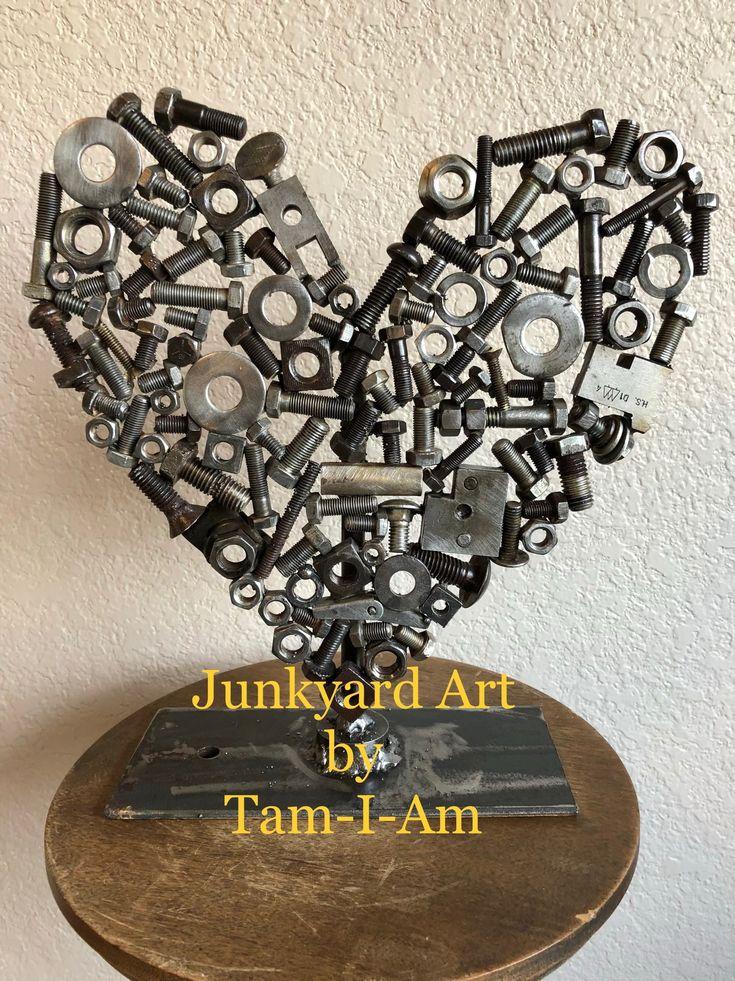 Junkyard Art by Tam-I-Am.  Tabletop heart sculpture made from a bucket of scrap bolts, nuts, etc.  Scrap metal art. Repurposed metal.