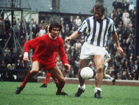 14th August 1971. Leicester City midfield player Jon Sammels closes down Huddersfield Town's Bobby Hoy.