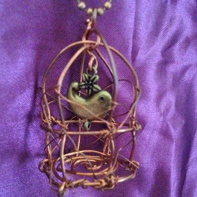 doinWire handcrafted copper wire Pendant. handcrafted copper bird cage with bird charm. (pic 2of2) DOW619