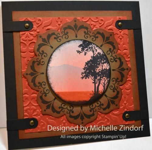 handmade card: Serene Scene – Stampin' Up! Card Tutorial #592 by Michelle Zindorf ... as always, a work fo art ... sunset silhouette scene famed by Floral Framit Frame ... browns and earthy rusty colors ... lots of layers ...